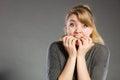 Nervous girl biting nails. Royalty Free Stock Photo