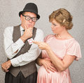 Nervous man and lady with contraceptives worried men in hat pregnant women holding Royalty Free Stock Photos