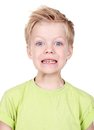 Nervous portrait of a cute little boy posing for camera isolated on white background Stock Photography