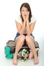 Nervous Scared Anxious Young Woman Sitting on an Overflowing Suitcase Royalty Free Stock Photo