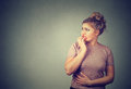 Nervous stressed young concerned woman biting fingernails looking anxiously Royalty Free Stock Photo