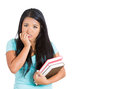 Nervous student carrying books in one arm and biting fingernails in other closeup portrait of isolated on white background with Royalty Free Stock Images
