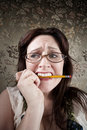 Nervous Woman Chewing on a Pencil Royalty Free Stock Photo