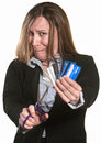 Nervous Woman Cuts Credit Cards Stock Photo