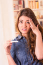 Nervous young girl holding pregnancy test Royalty Free Stock Photo