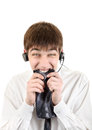 Nervous young man in headphones bite his necktie isolated on the white background Royalty Free Stock Image