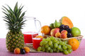 Nest with fruit a a jug of red orange juice and an applepie towering Royalty Free Stock Image