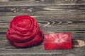 Net bath sponge and soap red color on wooden background Royalty Free Stock Photo