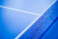 Net on blue ping pong table Royalty Free Stock Photo