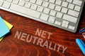 Net neutrality written on a wooden surface. Royalty Free Stock Photo