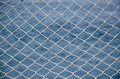 Net over blue sea a a background Royalty Free Stock Images