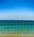 Net over blue sky and sea waves Royalty Free Stock Photo