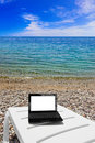 Netbook on beach Stock Photo