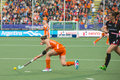 Netherlands beats belgium during the hockey world cup hague june dutch jonker is passing ball player de groof is right behind her Stock Images