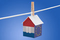 Netherlands dutch and eu flag on paper house concept painted a hanging a rope Royalty Free Stock Photography