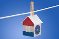 Netherlands dutch and eu flag on paper house concept painted a hanging a rope Royalty Free Stock Images