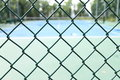 Netting the is in front of the tennis court Stock Image