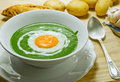 Nettle cream soup with egg cooked at low temperature Stock Photos