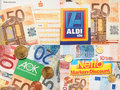 Netto sparkasse aldi and aok money logos surrounded by euro either for earnings or costs copy Stock Photo