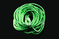 Network cable green on black background Stock Photos