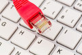 Network cable on keyboard symbol photo for this pc e commerce global communication Royalty Free Stock Image