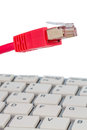 Network cable on keyboard to symbol photo for flat rate e commerce global communication Royalty Free Stock Images