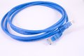 Network cable patch cord to internet connection Stock Photography