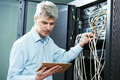 Network engineer administrator in server room Royalty Free Stock Photo
