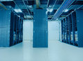 Network server room routers and fiber optical cables Royalty Free Stock Images