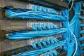 Network switch and ethernet cables Royalty Free Stock Photo