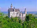 Neuschwanstein castle is a nineteenth century romanesque revival palace on a rugged hill above the village of hohenschwangau near Royalty Free Stock Photography