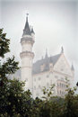 Neuschwanstein castle a shot of the famous in the morning fog Stock Photos