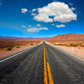 Never ending road to death valley california sunny desert Stock Photos