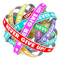 Never give up endless progress determination the words on an cycle of ribbons illustrating forward and neverending improvement Royalty Free Stock Image
