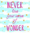 `NEVER lose your sense of WONDER` hand written text on background with grunge colored stripes and glittering golden