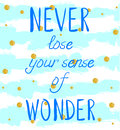 `NEVER lose your sense of WONDER` hand written text on background with grunge colored stripes and glittering golden Royalty Free Stock Photo