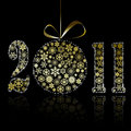 New 2011 year symbol made of gold snowflakes Royalty Free Stock Photo