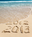 New 2013. The wave washes off an inscription 2012. Royalty Free Stock Photos