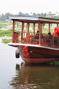 New adventure experience tourists passenger boat trip during holiday vacation at Floating market in Bangkok Thailand