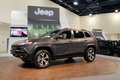 New american iconic suv at auto show front quarter side view of sport utility vehicle miami view of grille hood side windows and Stock Photography
