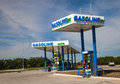 New anew flex fuel gas station pumps and signage on clear spring day against blue sky retail seller specializing in alternative Royalty Free Stock Photo