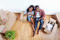 New apartment couple overhead view of young black african with moving boxes in using modern tablet computer technology Stock Photos