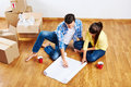 New apartment plans home floor couple moving in Stock Photography