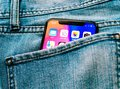 New Apple iPhone X 10 in pocket of denim jeans trousers Royalty Free Stock Photo