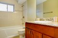 New bathroom interior with cherry sink cabinet. Royalty Free Stock Photo