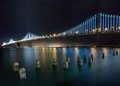 New bay bridge san francisco oakland at night from the embarcadero Stock Photos
