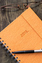 New beginning notebook and pen on rustic background Royalty Free Stock Images