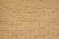 New beige sandstone wall Royalty Free Stock Photo