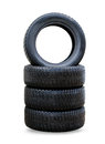 New black winter tyres for car stack of four wheel Stock Photo