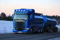 New Blue Scania Tank Truck Trucking in the Winter Twilight Royalty Free Stock Photo